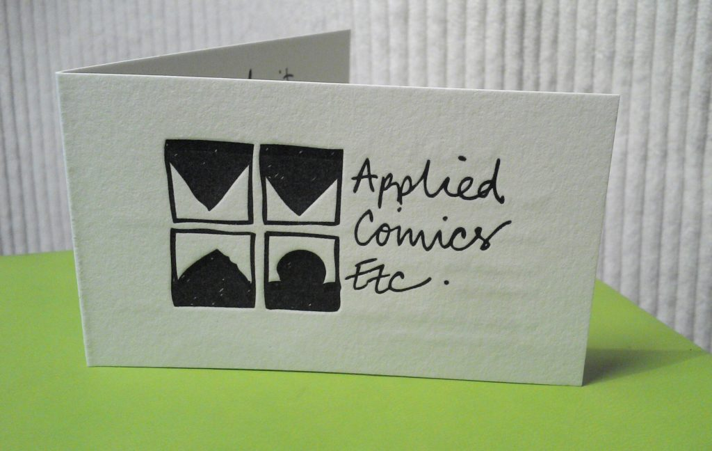Applied Comics Etc logo